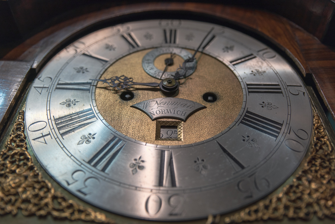 brass and silver clock dial