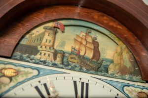 rocking ship grandfather clock in mahogany case